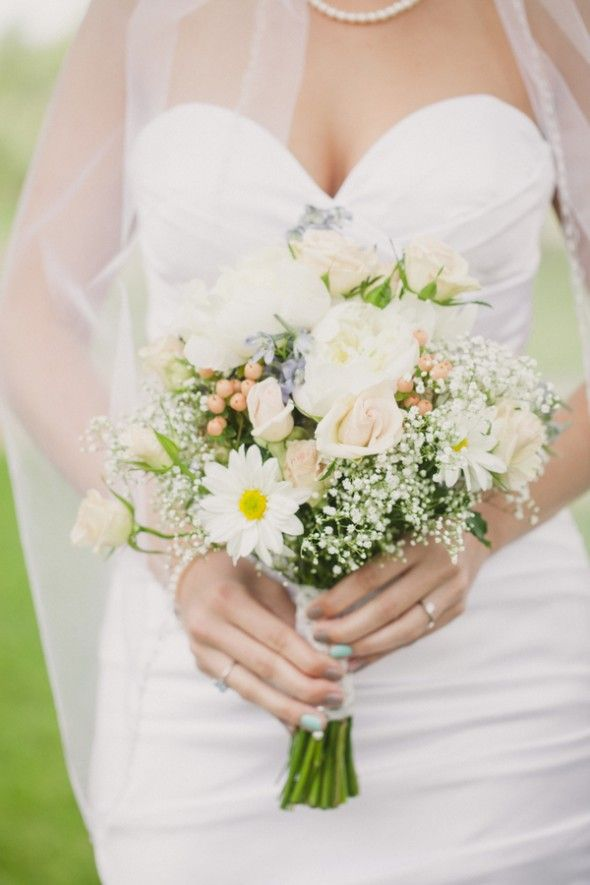 I would love to have a bouquet similar to this one. I love the touch of a few white daisy's with the baby's breath along with a hint or two of the soft pinks. I'm not dead set on roses one here and there would be fine but I seem to lean towards other flowers besides roses.