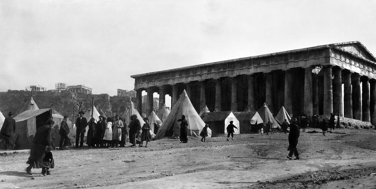 Greek Christian Refugees from Asia Minor (Turkey) settling in a refugee camp in Athens in front of the Temple of Theseus, 1922 Photographer: C.D Morris ...