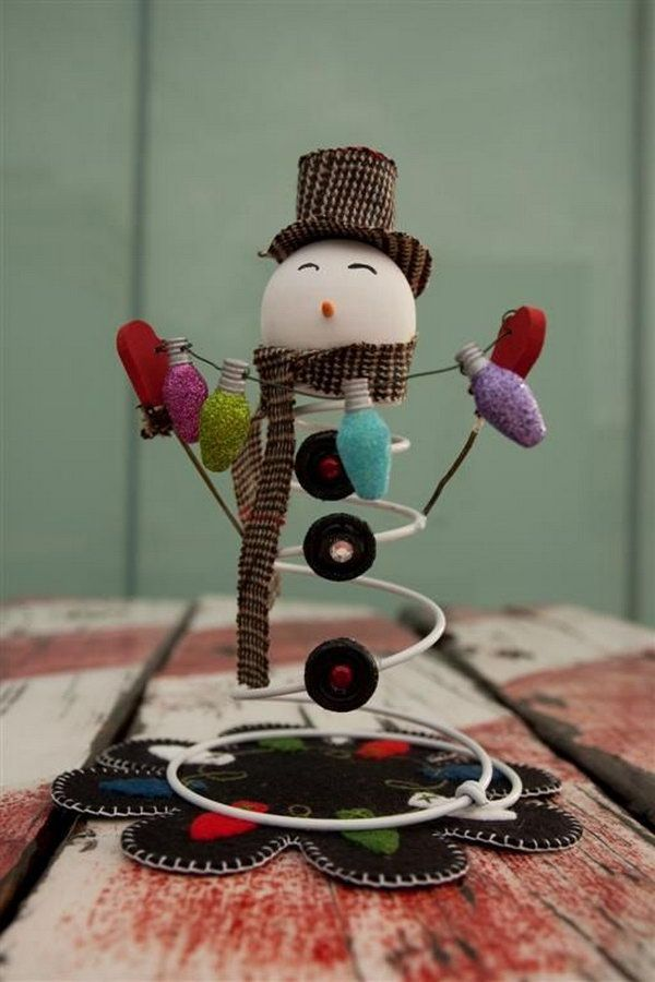 Adorable Snowman Made from an Old bed spring, a styrofoam ball and buttons, http://hative.com/diy-bed-spring-crafts/