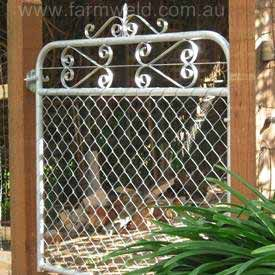 Cyclone mesh and wrought iron scrolls in heritage style gate. By Farmweld, South Australia