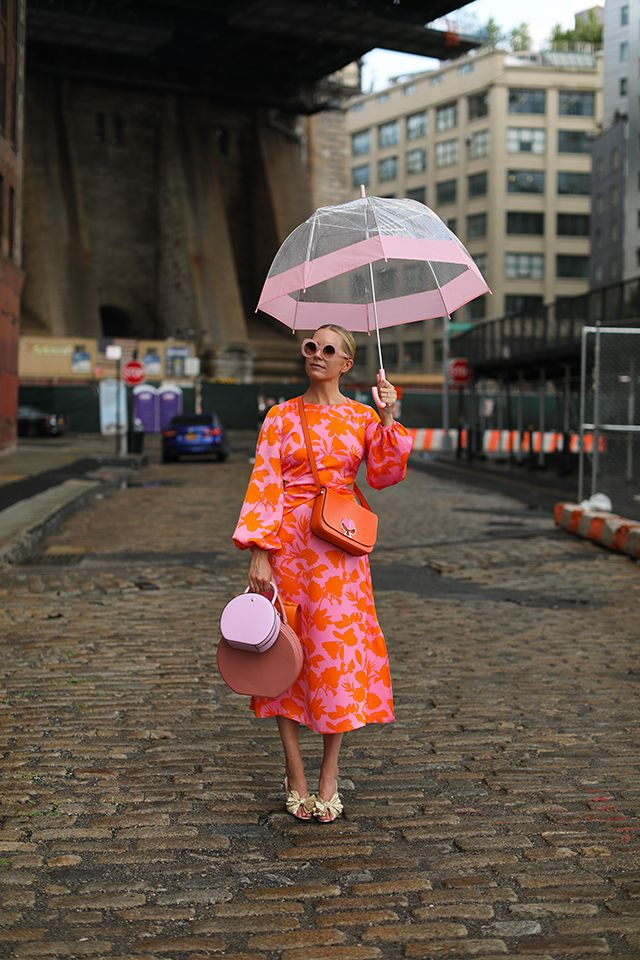 Blair Eadie sporting an orange and pink costume from ASOS and bag by Kate Spade // …