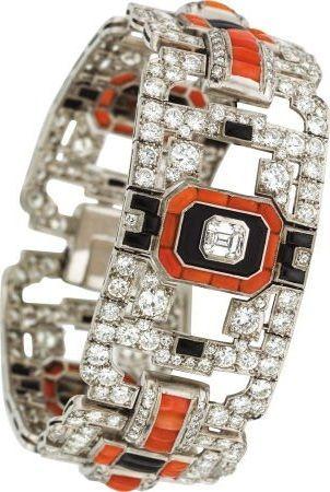 An Art Deco Diamond, Coral, Black Onyx, Platinum Bracelet
