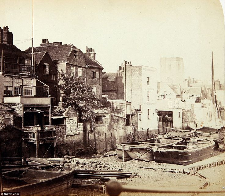 The Adam and Eve pub is pictured  with three large multi-paned square windows, balconies on all three levels and rickety steps leading down to the shore. The establishment was demolished to make way for the Chelsea Embankment. The pub was famously sketched by the American artist James Whistler, who adopted London as his home. This picture shows how the area was more socially and economically diverse in 1860.  In the background Chelsea Old Church is visible