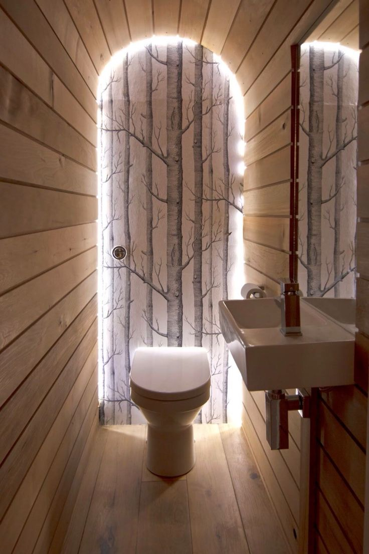 contemporary bathroom by barc architects ltd this cole sons woods wallpaper edged in led strips creates an ethereal ambience in the narrow space