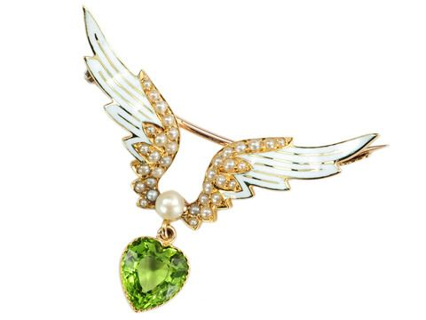 A gold, peridot, pearl and enamel jewel, c.1900, in the form of a heart surmounted by a pair of wings, symbolising the wings of love. (georgianjewelry.com)