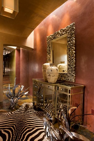 Rich color, zebra rug, mirror, lighting...very rich.....loose the silver looking roosters on the floor.  They are too distracting to a great design...