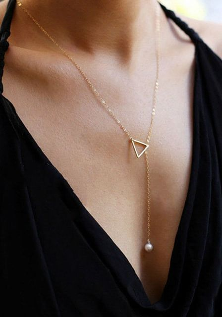 Accessories, like this gold triangle and pearl lariat necklace, are one of the best things that can jazz up any outfit!