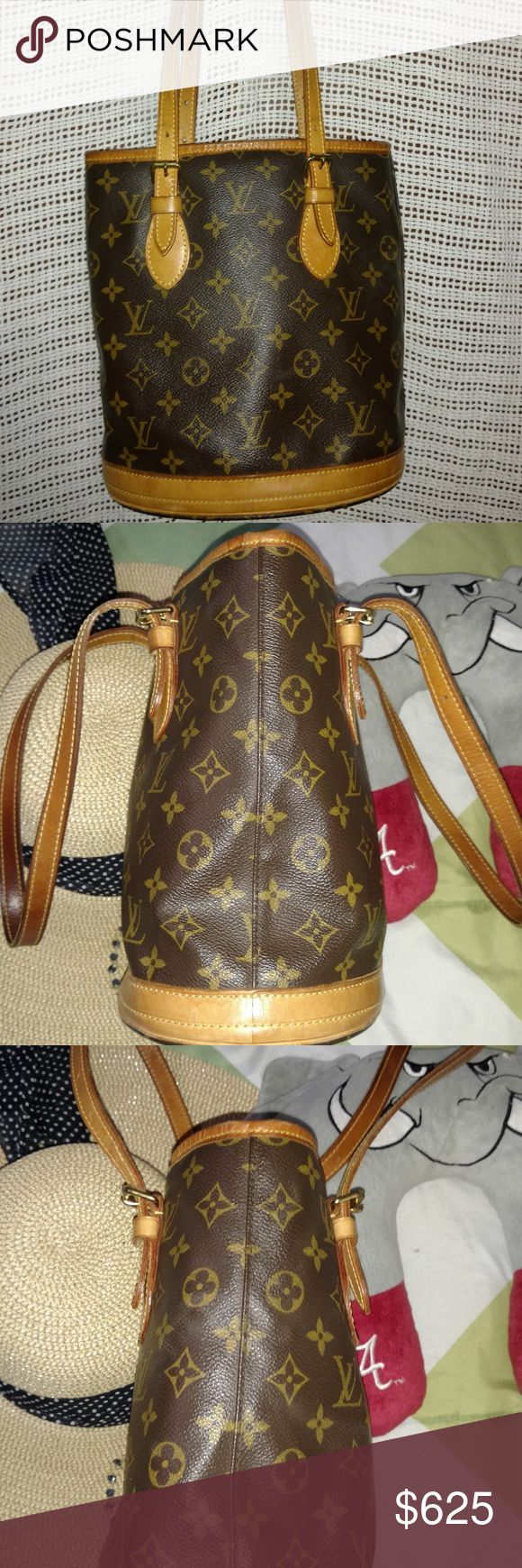 "Louis Vuitton Petit Bucket EUC Date Code SD0012 Louis Vuitton brown and tan monogram coated canvas bucket bag with brass hardware, tan vachetta leather trim, dual flat shoulder straps, beige coated canvas lining, dual pockets at interior walls; one zip closure and open top. Date Code: SD0012 Length 9"" Width 6"" Height 10"" Drop 8.5"" (adjustable)  Some small discoloration on trim and straps. Good previously used condition consistent with use. A few marks of the bottom of the bag nothing bad…"