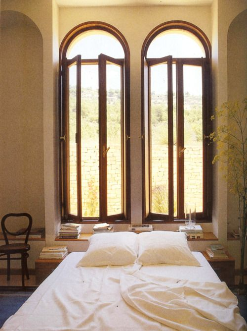 Small bedroom with big arched windows providing ample light   #Bedroom #InteriorDesign #Window  