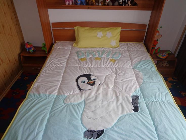 so cute- little penguin quiltted on a bedspread <3
