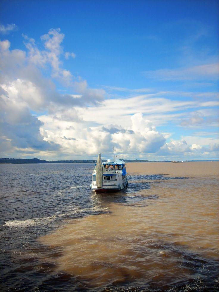 Encontro das águas - Where the black and light water meet in Manaus, Amazon
