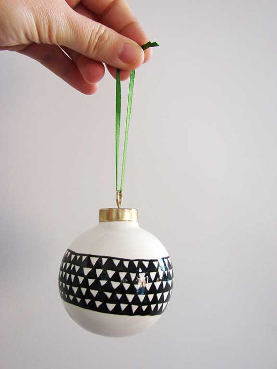 Get plain glass ornaments and decorate them with Sharpie for a mod themed tree.