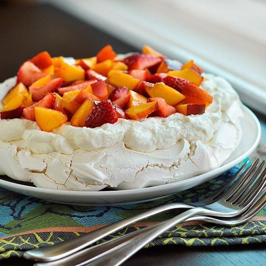 Despite being named after a world-class ballerina, I can't help but think of the pavlova as a rather humble and homely thing. I love the way the billowy whipped cream slumps into the cracked surface of the meringue, making a cozy nest for the fruit to rest. But perhaps the pavlova was named for the way it tastes: an arabesque of sweetness, a leap of airy confection, the beloved pas de deux of fresh fruit and cream. Like Anna Pavlova herself, it's perfect.