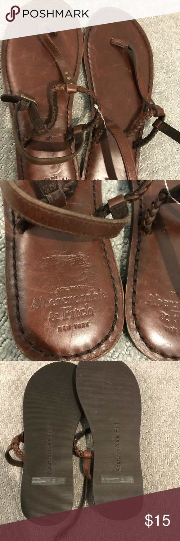 Abercrombie M8/9 brown leather sandals never worn Never been worn. The paper tag got ripped off but the clear tag is still on them. Never worn size 8/9 Abercrombie and fitch. Minor smudge from storing but won't see while being worn. Abercrombie & Fitch Shoes Sandals