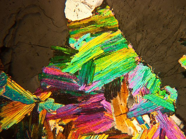 This is what you see when you look at thin sections of mica and quartz in a polarizing microscope.