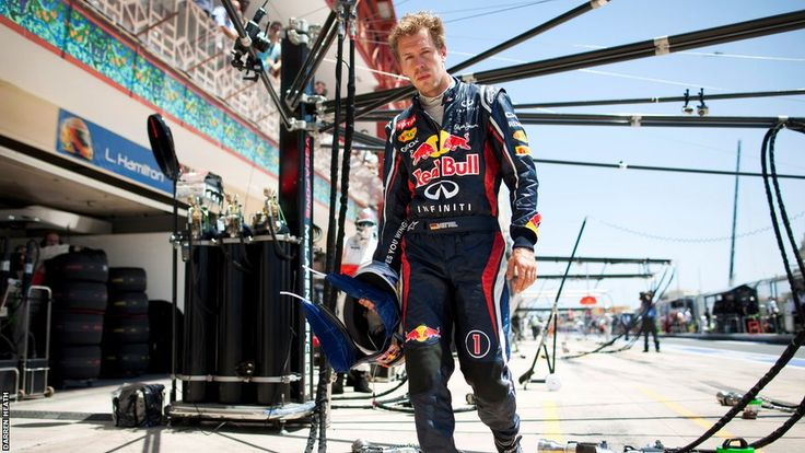 Sebastian Vettel's thunderous mood following his retirement from the lead of the European Grand Prix is captured as he walks back to the Red Bull pit
