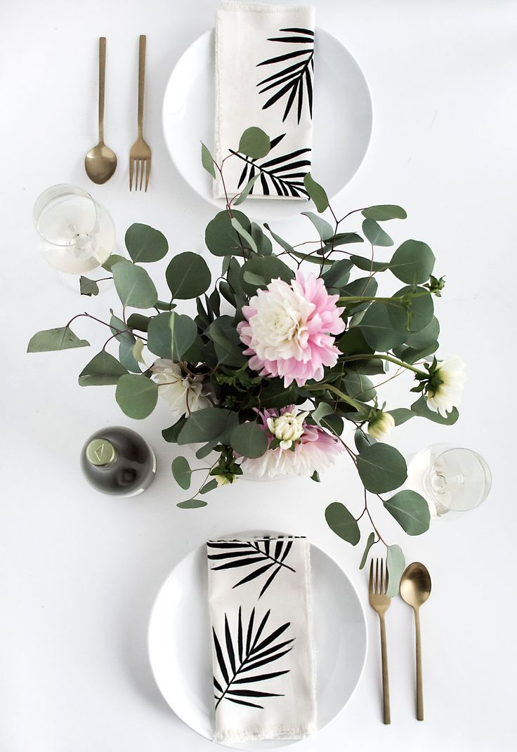 Simple bridal shower decor idea -white plates with palm leaf napkins {Courtesy of Homey Oh My}