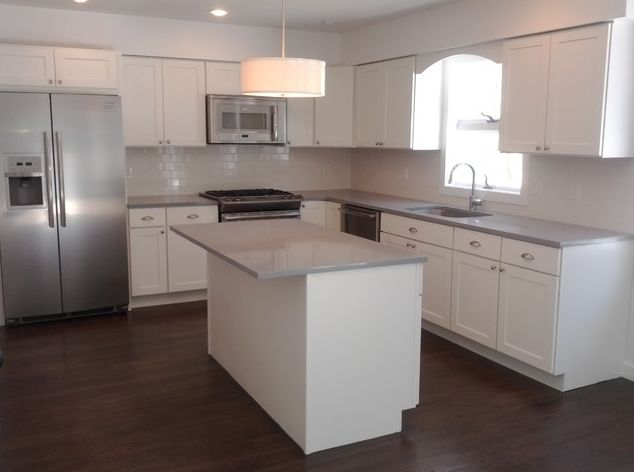 white shaker cabinets/ grey counter tops/ cup pulls/ whitesubwaytile