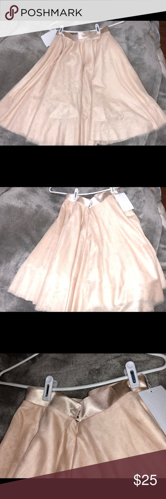 Champagne Tutu Skirt US Size 0/2 NWT I'm selling a never worn above-the-knee length champagne color tutu skirt with satin waist band. Although the tag says M, it's an Asian M and actually runs fairly small. So if you're considering buying you should be a TRUE size US 0 or 2 or else this WON'T fit you! Zip + hook & eye closure. Super cute, with several layers of tulle and fully lined so you won't need a slip. This isn't a poofy tutu so if you want a very full effect, you'll need to pair this…