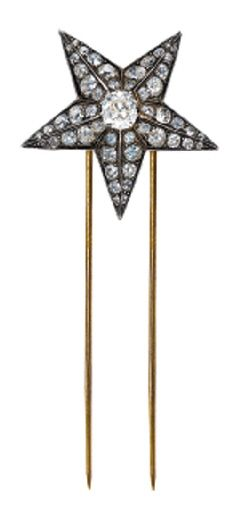 A DIAMOND STAR HAIR ORNAMENT   Designed as an old mine-cut diamond five-point star to the articulated pin, circa 1870