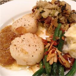 Scallops with White Wine Sauce II - Allrecipes.com  I made this tonight and it was fantastic.