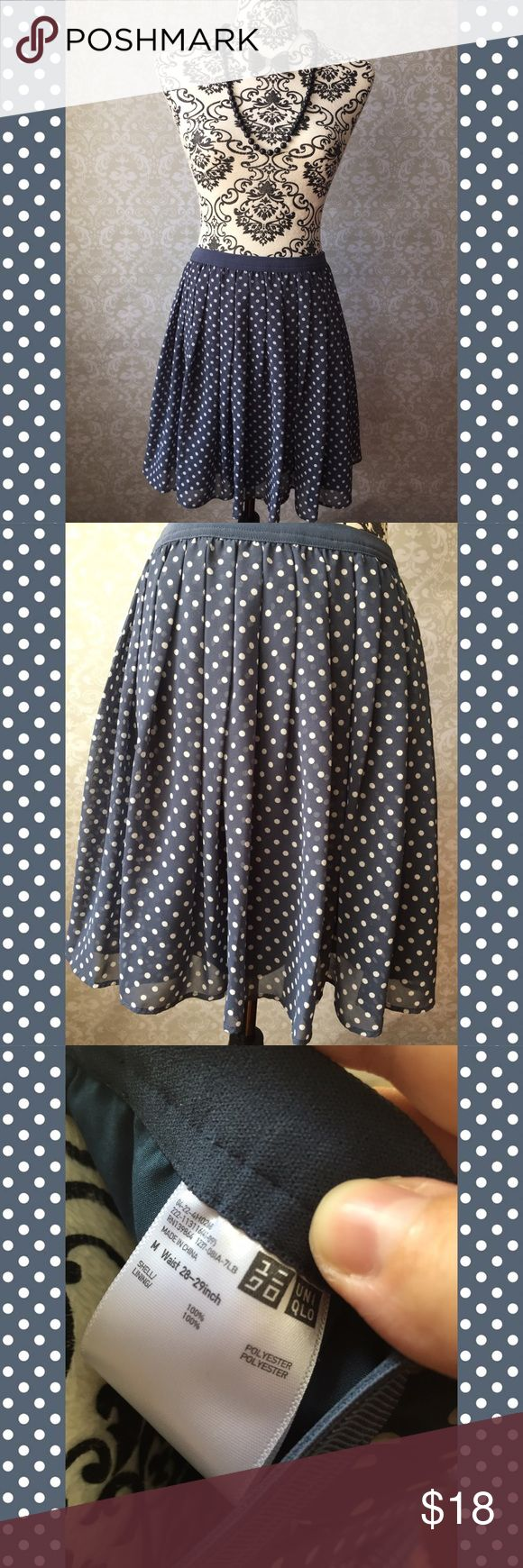 """Uniqlo blue polka dot skater skirt Flouncy dual-layer Uniqlo skirt in a denim/dusty blue. Semi-sheer top layer features polka dot print, and base layer is solid blue. Lots of movement. Worn once. Tag gives waist measurement as 28""""-29"""", but I think it has a little flexibility size-wise because of the elastic waist. Solid color elastic blue waistband. Excellent condition. I have a very similar purple Uniqlo skirt listed. Uniqlo Skirts Circle & Skater"""