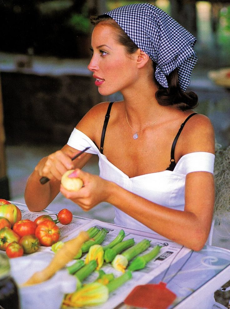 Christy Turlington.  i didn't know what category to put this in...but hello gorgeous...bandana, over the shoulder white shirt, peeling veggies....now THAT is beauty.
