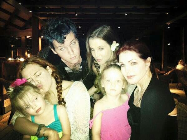 Elvis' daughter, grandchildren & exwife!! Ben favors Elvis a lot :)