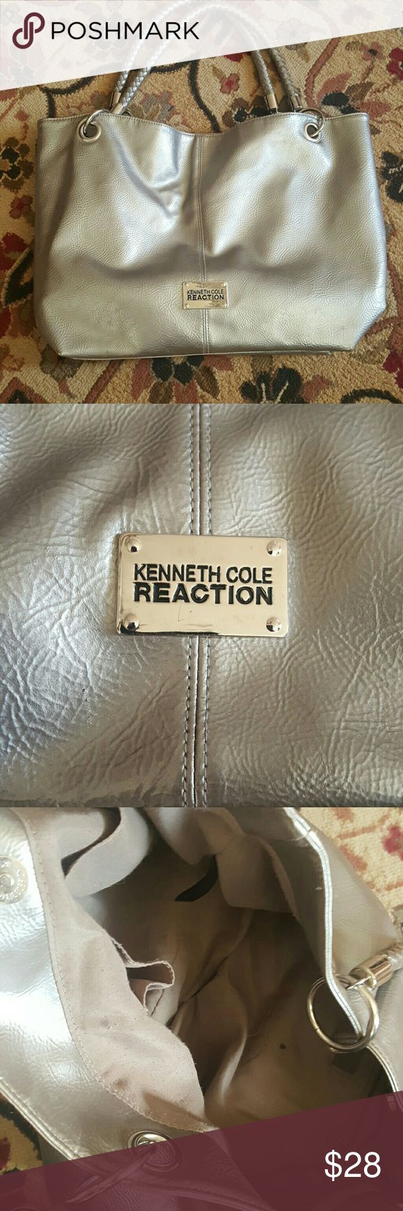 Kenneth Cole Reaction silver tote bag This is a beautiful Kenneth Cole Reaction silver tote bag. It is in great shape exceptthe inside is a little torn, with a few stains. It's 18 inches wide and 14 inches long From top of handlestobottomofthepurseitis 22 inches long. Kenneth Cole Reaction Bags Totes