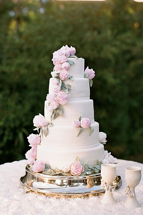 Peony Wedding Cake - Uniquely Southern Wedding Cakes - Southernliving. This delicate five-tiered cake was covered with peonies and set atop a an elegant silver stand. Love It? Get It!Confections on the Coast; 850/259-5102