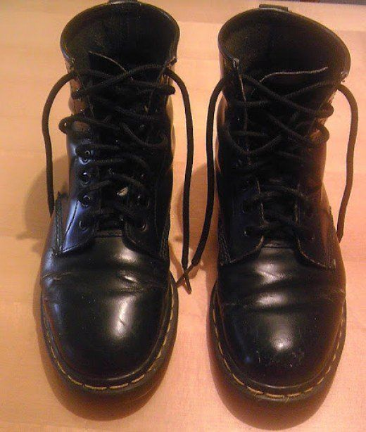 A happily broken-in pair of smooth black Doc Martens. At the time of this picture, these boots had been in service for 16 years!