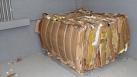 Compacted cardboard bale from Bramidan B6030 vertical baler