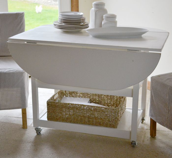 "I want to make this!  DIY Furniture Plan from Ana-White.com  How to build a drop leaf storage table with free, simple, step by step plans from Ana-White.com. This would be the PERFECT table for our TINY ""dining room"""