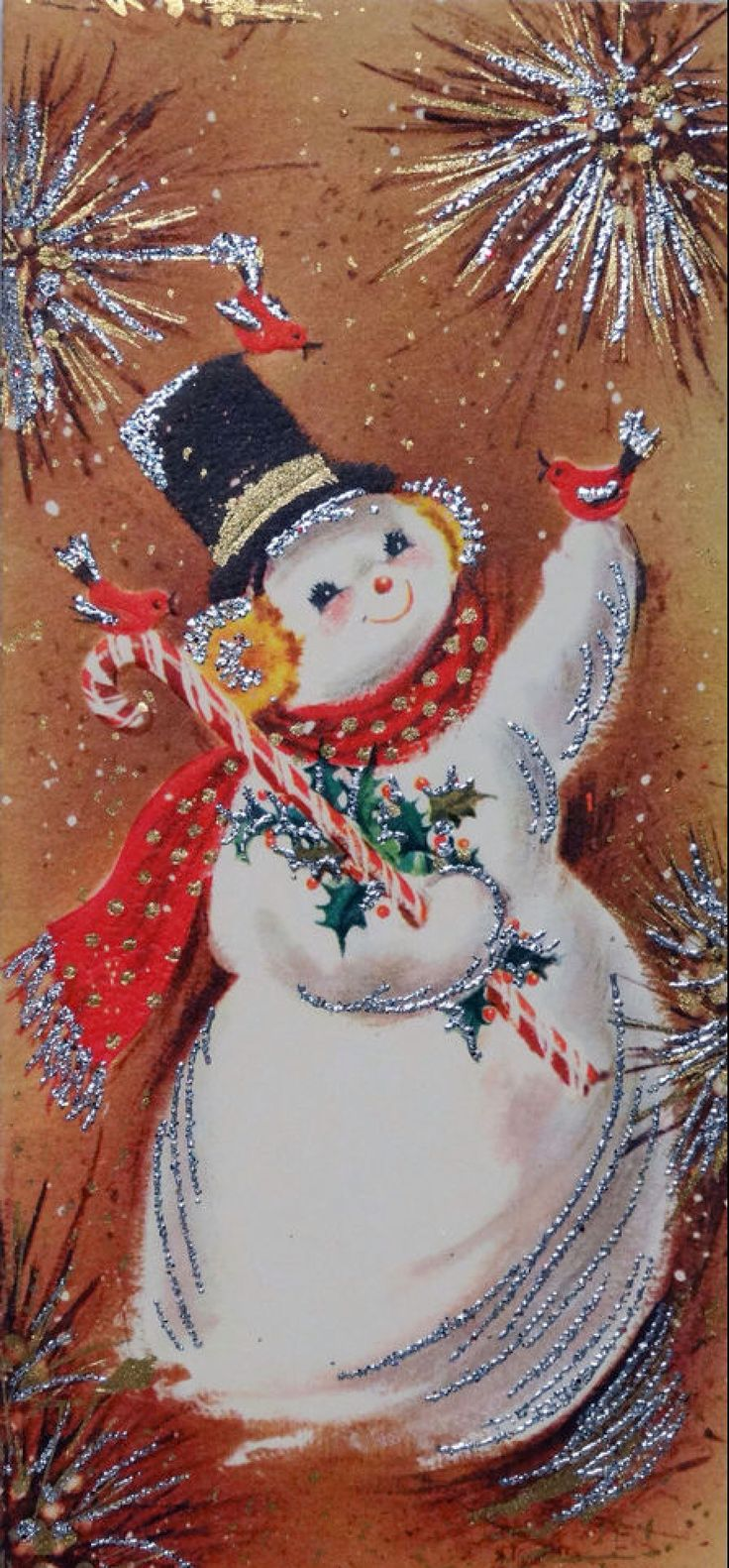 This vintage Christmas card with glitter and a smiling snowman looks like something from my childhood.