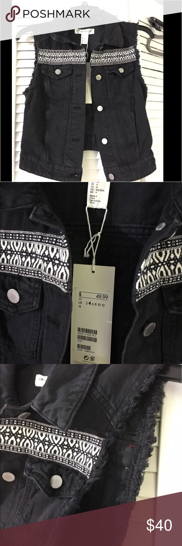 Coachella inspired black denim vest by H&M This Coachella inspired black denim vest is the perfect addition to any bohemian style closet! Very light weight and bright with colors, this piece can be worn as a statement year around Jackets & Coats Vests