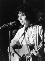 Loretta Lynn performs onstage at the Grand Ole Opry in 1965.