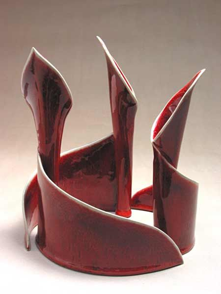 """Fire Works Pottery - CandleLilies: Set of 3 elegant nesting candlesticks may be arranged many ways. Can also hold flowers. Inspired by the graceful forms of calla lilies. Graduated heights-8"""", 9"""",10"""" Shown in Copper Red."""