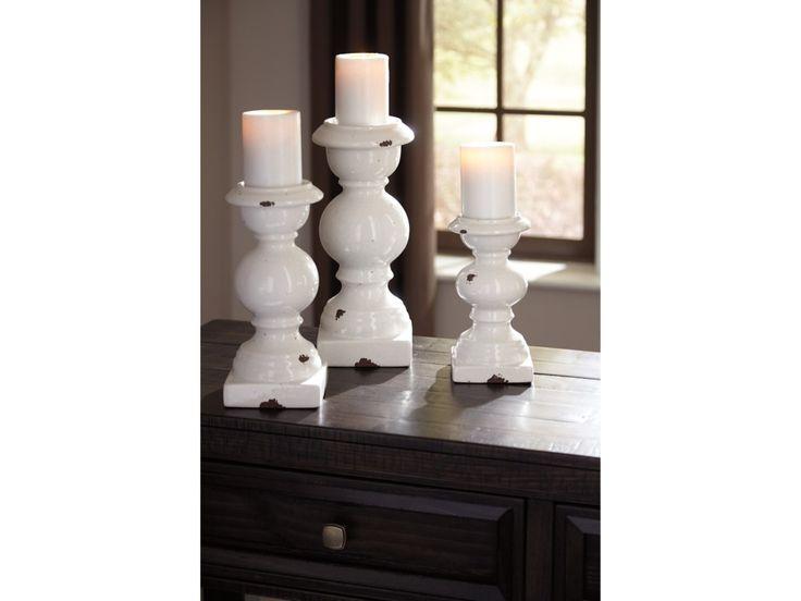 "Accents Devorah Antique White Candle Holder Set  Set of 3 Candle Holders (Candles Not Included). Antique White Glazed Ceramic.  Candle holder-small 5.00"" x 5.00"" x 9.00"" Candle holder-medium 5.50"" x 5.50"" x 11.25"" Candle holder-large 6.50"" x 6.50"" x 13.50""  The Accents Devorah Antique White Candle Holder Set by Signature Design by Ashley at Furniture Superstore - NM in the Albuquerque, Los Ranchos De Albuquerque, Rio Rancho, Santa Fe, Corrales, NM area."