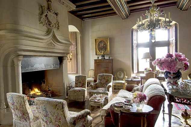 Designer Rachel Riley's fairy tale 16th century chateau in France. I've collected pictures of her home every time I've come across it over the years. My favorite is the bathroom wallpaper which is blue with white doves.