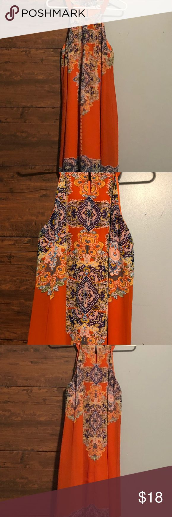 Vibrant sleeveless Spring/Summer Dress size L Vibrant sleeveless Spring/Summer Dress size L  Beautiful orange, yellow, navy, light blue, tan and pink colors Perfect for any occasion Dresses