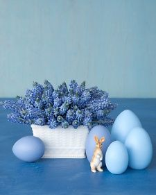 Love this Easter centerpiece idea  - hyacinths or mascari and painted wooden eggs.