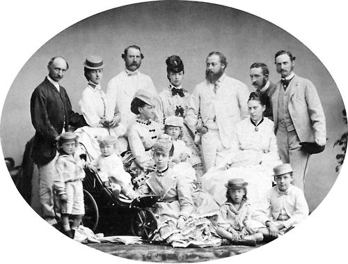 1869.  Standing, l-r: The sisters' paternal uncle, Prince Wilhelm of Glücksburg; Alexandra; their father, King Christian IX of Denmark; Dagmar; Alexandra's husband, the future King Edward VII; the sisters' paternal uncle, Prince Hans of Glücksburg; their brother, Frederick.  Sitting, l-r: Alexandra's son, George; Dagmar's son, Nicholas; their mother, Queen Louise, holding Alexandra's daughter, Louise; their sister, Thyra; Alexandra's son, Albert Edward; and their brother, Waldemar.