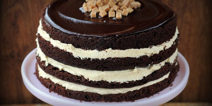 This homemade chocolate fudge cake has a special twist as it is filled with a salted caramel buttercream filling and topped with a chocolate fudge sauce.