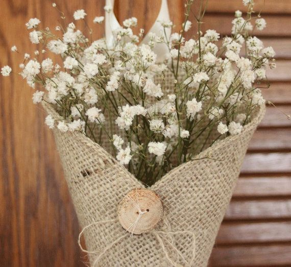 burlap bows with babys breath | burlap pew cone with baby's breath | Wedding stuff