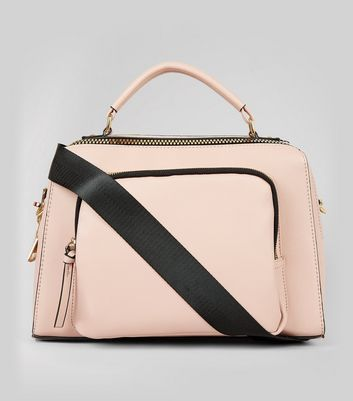 - Leather-look finish- Chunky zip detail- Pocket front design- Adjustable shoulder strap- L: 32cm, W: 13cm, H: 22.5cm