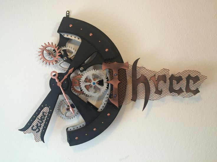 Handmade kinetic wall clock sculpture, crafted of MDF boards and metal. The quartz clock movement is German, high torque, requires 1 pc AA battery (included). The gear movement is separated from the clock movement, needs 220/230V. Color: black with silver and copper gears, with copper elements. Measures: 115 cm (45 in) wide, 80 cm (31 in) high, 13 cm (5 in) deep. The clock weighs 11 kg (24,44 lb).