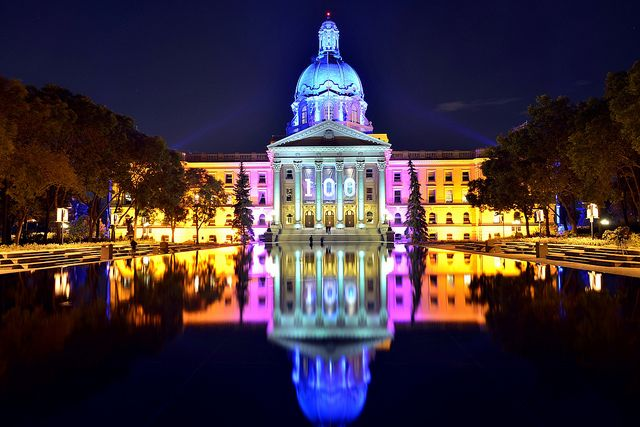 Alberta Legislature 100 Anniversary (in Edmonton, AB, Canada). The colour is lighting on the building. Photo by bulliver, via Flickr