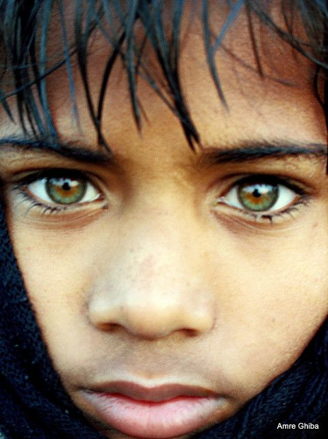 Green-eyed indian boy during Ardh Kumbh Mela |The most beautiful eyes | My National Geographic cover portrait | Somehow related to Mc Curry's Afghan Girl with beautiful eyes ? by Amre Ghiba, via Flickr