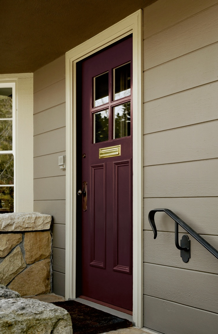 Traditional gray palette on exterior with the rich accent of plum on doors