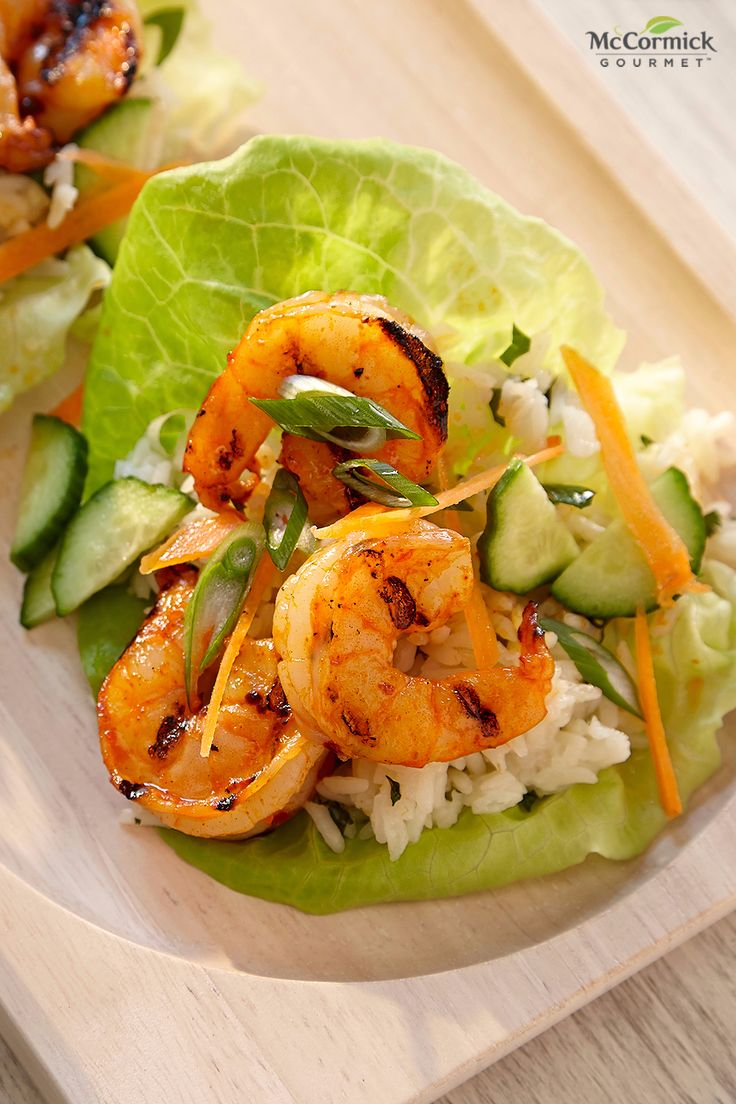 Fresh lettuce leaves make a great wrapping for grilled shrimp and cilantro flecked rice in this easy shrimp lettuce wraps recipe. Sriracha seasoning brings a touch of heat in this homemade sriracha mayo topping. This easy grilled shrimp recipe will sure to be a hit at your summer cookout.